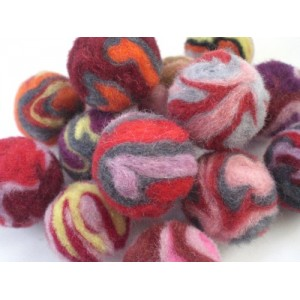 http://craftsandfelt.com/128-174-thickbox/felt-wool-swirly-pom-poms.jpg