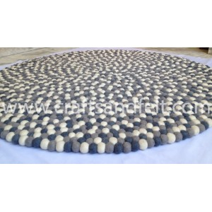 http://craftsandfelt.com/471-1252-thickbox/100cm-mixed-grey-and-white-felt-ball-rug.jpg