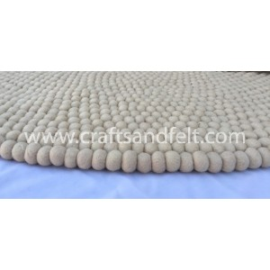 http://craftsandfelt.com/495-1321-thickbox/140cm-off-white-felt-ball-rug.jpg