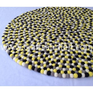 http://craftsandfelt.com/538-1279-thickbox/90cm-brimstone-yellow-felt-ball-rug.jpg